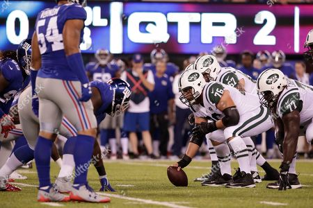 New York Jets center Wesley Johnson and James Carpenter (77) play during the first half of a preseason NFL football game against the New York Giants, in East Rutherford, N.J