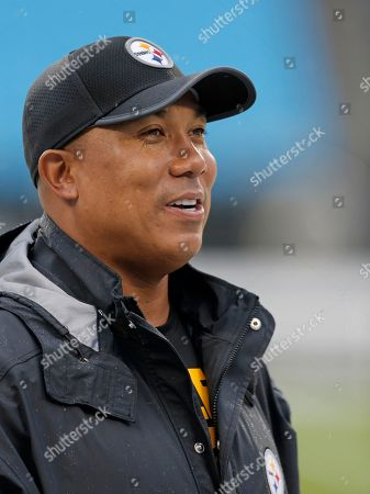 Former Pittsburgh Steelers wide receiver Hines Ward walks the sidelines before an NFL preseason football game against the Carolina Panthers in Charlotte, N.C