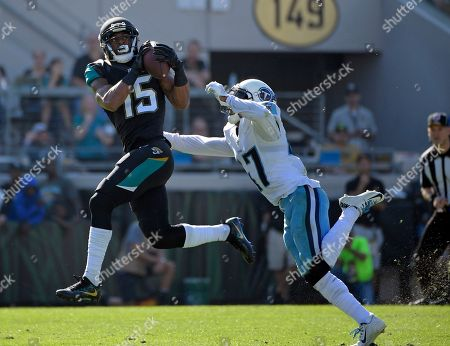Jacksonville Jaguars wide receiver Allen Robinson (15) catches a pass in front of Tennessee Titans defensive back Valentino Blake during the first half of an NFL football game, in Jacksonville, Fla