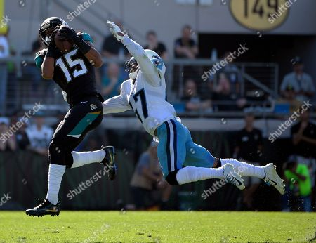 Allen Robinson, Valentino Blake. Jacksonville Jaguars wide receiver Allen Robinson (15) catches a pass in front of Tennessee Titans defensive back Valentino Blake during the first half of an NFL football game, in Jacksonville, Fla