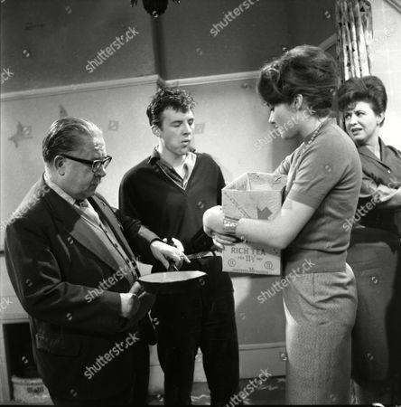 Stock Image of Jack Howarth (as Albert Tatlock), Philp Lowrie (as Dennis Tanner), Anne Cunningham (asa Linda Cheveski) and Pat Phoenix (as Elsie Tanner)