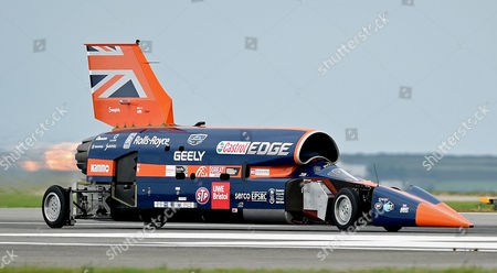 Stock Image of The Supersonic car Bloodhound SSC taxies on the runway during a test session at Newquay Airport, Cornwall, Britain 26 October 2017. Driven by world landspeed record holder and fighter pilot Andy Green, the Bloodhound SSC reaches 200mph in five seconds during the testing. Designed by 87-year old aerodynamisist Ron Ayers in collaboration with Richard Noble of Thrust 2 fame, the Bloodhound is predicted to reach 1000mph in landspeed record attempt, on the Hanskeen Pan desert in South Africa.