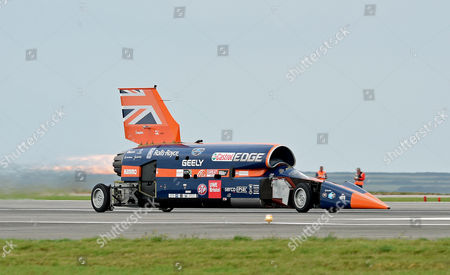 Stock Picture of The Supersonic car Bloodhound SSC speeds off on the runway during a test session at Newquay Airport, Cornwall, Britain 26 October 2017. Driven by world landspeed record holder and fighter pilot Andy Green, the Bloodhound SSC reaches 200mph in five seconds during the testing. Designed by 87-year old aerodynamisist Ron Ayers in collaboration with Richard Noble of Thrust 2 fame, the Bloodhound is predicted to reach 1000mph in landspeed record attempt, on the Hanskeen Pan desert in South Africa.