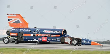 The Supersonic car Bloodhound SSC speeds off on the runway during a test session at Newquay Airport, Cornwall, Britain 26 October 2017. Driven by world landspeed record holder and fighter pilot Andy Green, the Bloodhound SSC reaches 200mph in five seconds during the testing. Designed by 87-year old aerodynamisist Ron Ayers in collaboration with Richard Noble of Thrust 2 fame, the Bloodhound is predicted to reach 1000mph in landspeed record attempt, on the Hanskeen Pan desert in South Africa.