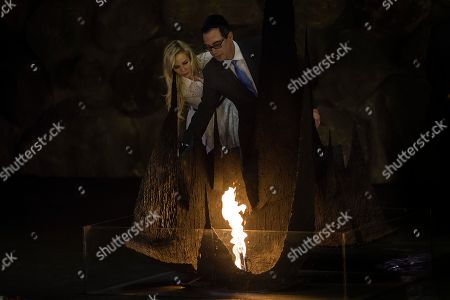 In this Thursday, Oct, 26, 2917 photo, United States Secretary of the Treasury Steven Mnuchin and his wife Louise Linton visit Yad Vashem Holocaust memorial in Jerusalem