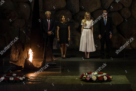 In this Thursday, Oct, 26, 2917 photo, United States Secretary of the Treasury Steven Mnuchin and his wife Louise Linton, on the right, and U.S. ambassador to Israel David Friedman and his wife Tammy Deborah Sand visit Yad Vashem Holocaust memorial in Jerusalem