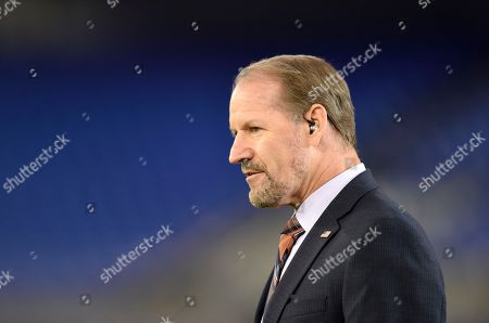 Bill Cowher stands on the field before an NFL football game between the Baltimore Ravens and the Miami Dolphins, in Baltimore