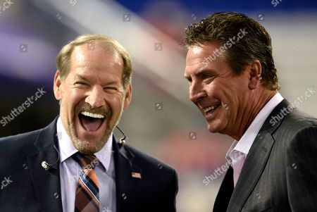 Bill Cowher, Dan Marino. Bill Cowher, left, and Dan Marino chat before an NFL football game between the Baltimore Ravens and the Miami Dolphins, in Baltimore