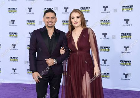 Larry Hernandez, Kenia Ontiveros. Larry Hernandez, left, and Kenia Ontiveros arrives at the Latin American Music Awards at the Dolby Theatre, in Los Angeles