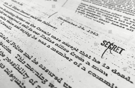 Stock Photo of Part of a file, dated Nov. 24, 1963, quoting FBI director J. Edgar Hoover as he talks about the death of Lee Harvey Oswald, released for the first time, is photographed in Washington. The public is getting a look at thousands of secret government files related to President John F. Kennedy's assassination, but hundreds of other documents will remain under wraps for now. The government was required by Thursday to release the final batch of files related to Kennedy's assassination in Dallas on Nov. 22, 1963. But President Donald Trump delayed the release of some of the files, citing security concerns