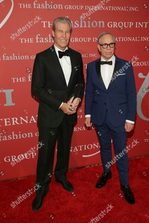 "Terry Lundgren, Tommy Hilfiger. Humanitarian Award recipient/Chairman of Macy's, Inc. Terry Lundgren, left, and presenter Tommy Hilfiger pose during The Fashion Group International's ""Night of Stars"" gala at Cipriani Wall Street on Thursday, Oct. 26, in New York"