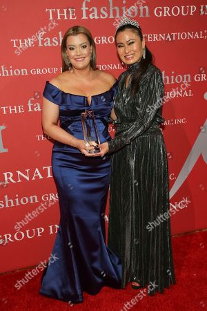 """Rebecca Minkoff, SunHee Grinnell. Beauty Award recipient Rebecca Minkoff, left, and presenter SunHee Grinnell pose during The Fashion Group International's """"Night of Stars"""" gala at Cipriani Wall Street on Thursday, Oct. 26, in New York"""