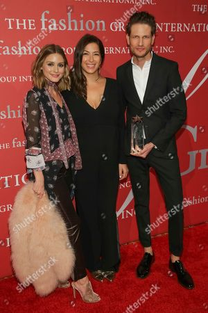"Olivia Palermo, Rebecca Minkoff, Uri Minkoff. Presenter Olivia Palermo, from left, Technology In Brand Development Award recipients Rebecca Minkoff and Uri Minkoff pose during The Fashion Group International's ""Night of Stars"" gala at Cipriani Wall Street on Thursday, Oct. 26, in New York"