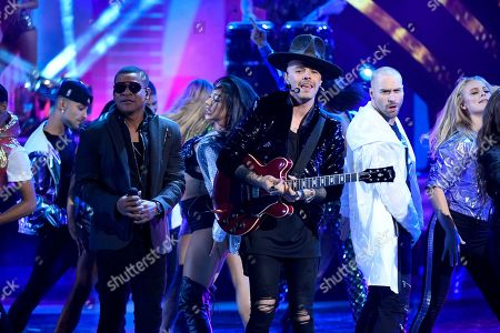 """Randy Malcom Martinez, Jesse Huerta. Randy Malcom Martinez of Gente De Zona, left, and Jesse Huerta of Jesse & Joy perform """"3 AM"""" at the Latin American Music Awards at the Dolby Theatre, in Los Angeles"""