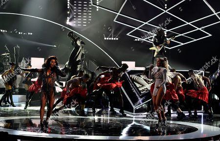 "Alejandra Guzman, Gloria Trevi. Alejandra Guzman, left, and Gloria Trevi perform ""Mas Buena"" at the Latin American Music Awards at the Dolby Theatre, in Los Angeles"