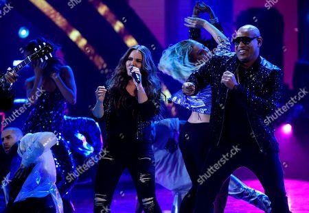 "Joy Huerta, Randy Malcom Martinez. Joy Huerta of Jesse & Joy, left, and Alexander Delgado of Gente De Zona perform ""3 AM"" at the Latin American Music Awards at the Dolby Theatre, in Los Angeles"