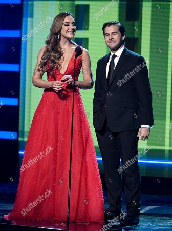 Stock Picture of Ana Belena, Julio Vaqueiro. Ana Belena, left, and Julio Vaqueiro speak at the Latin American Music Awards at the Dolby Theatre, in Los Angeles