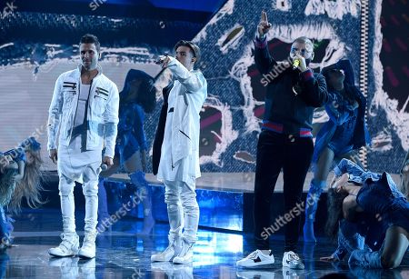 Christian Daniel, Abraham Mateo, Farruko. Christian Daniel, from left, Abraham Mateo, and Farruko perform at the Latin American Music Awards at the Dolby Theatre, in Los Angeles