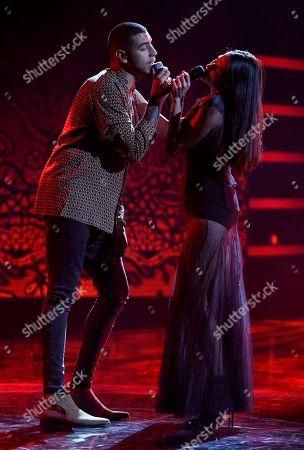 "Manuel Medrano, Natalia Jimenez. Manuel Medrano, left, and Natalia Jimenez perform ""La Mujer Que Bota Fuego"" at the Latin American Music Awards at the Dolby Theatre, in Los Angeles"