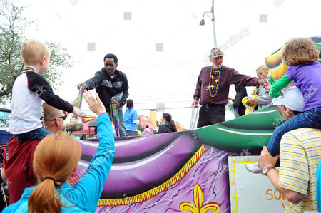 Dwight Henry, star of the Academy Award nominated film Beasts of the Southern Wild, and cast member Lowell Landis hand out beads in the Argus parade on Mardi Gras on in Metairie, La