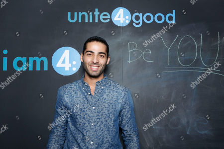 """Actor Jason Canela declares what he stands for at the Celebration of Local Heroes during unite4:good Day of Unity - Miami joining volunteers, celebrities and community leaders at the Ice Palace Film Studios on Monday, January, 20, 2014 in Miami, FL. unite4:good is the global movement for humanity whose mission is to inspire charitable action globally. With the support of local organizations and volunteers, the unite4:good movement launched in Miami and consisted in a variety of events and activities â?"""" ranging from painting murals in Overtown to organizing donated items at the Chapman warehouse helping homeless families. Miami-Dade County issued a proclamation deeming January, 20, unite4:good Day"""