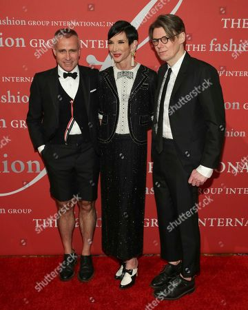 """Thom Browne, Amy Fine Collins, Andrew Bolton. Honoree Thom Browne, from left, Amy Fine Collins and Andrew Bolton attend The Fashion Group International's """"Night of Stars"""" gala at Cipriani Wall Street on Thursday, Oct. 26, in New York"""