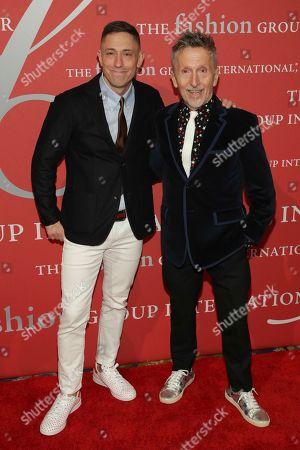 "Jonathan Adler, Simon Doonan. Jonathan Adler, left, and event host Simon Doonan attend The Fashion Group International's ""Night of Stars"" gala at Cipriani Wall Street on Thursday, Oct. 26, in New York"
