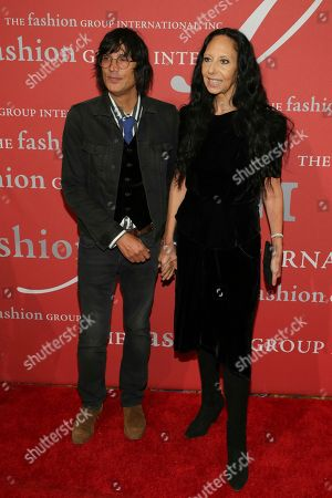 "Vinoodh Matadin, Inez van Lamsweerde. Vinoodh Matadin, left, and presenter Inez van Lamsweerde attend The Fashion Group International's ""Night of Stars"" gala at Cipriani Wall Street on Thursday, Oct. 26, in New York"