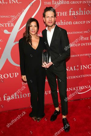 "Rebecca Minkoff, Uri Minkoff. Technology In Brand Development Award recipients Rebecca Minkoff, left, and Uri Minkoff pose during The Fashion Group International's ""Night of Stars"" gala at Cipriani Wall Street on Thursday, Oct. 26, in New York"
