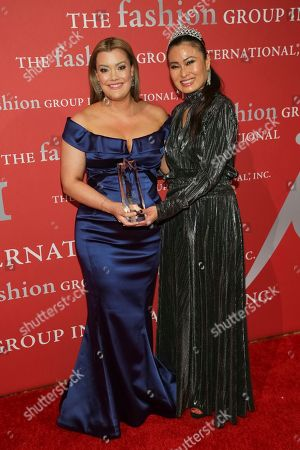 """Jamie Kern Lima, SunHee Grinnell. Beauty Award recipient Jamie Kern Lima left, and presenter SunHee Grinnell pose during The Fashion Group International's """"Night of Stars"""" gala at Cipriani Wall Street on Thursday, Oct. 26, in New York"""