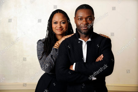 """Ava DuVernay, left, director of the film """"Selma,"""" and cast member, David Oyelowo, who plays Martin Luther King Jr., pose together at the Four Seasons Hotel in Los Angeles. The widely acclaimed movie """"Selma"""" about the 1965 Civil Rights movement has disappointed at least one moviegoer: a leading historian of President Lyndon B. Johnson. The director of the LBJ Presidential Library in Austin, which hosted a major civil rights summit this year that was headlined by four U.S. presidents, said the film that opens in theaters Thursday, Dec. 25, 2014, incorrectly portrays Johnson as an obstructionist to the Rev. Dr. Martin Luther King Jr"""
