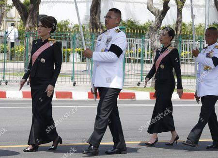 Thai Princess Ubolratana Rajakanya (L), elder sister of Thai King Maha Vajiralongkorn Bodindradebayavarangkun, and Princess Bajrakitiyabha (R), daughter of King Maha Vajiralongkorn Bodindradebayavarangkun march with the royal guards during the royal procession transferring the royal relics and ashes of the late Thai King Bhumibol Adulyadej in Bangkok, Thailand, 27 October 2017. Thais bid their final farewell to the late King Bhumibol Adulyadej in an elaborate royal funeral ceremony. King Bhumibol died at the age of 88 in Siriraj hospital on 13 October 2016 after 70 years on the throne.
