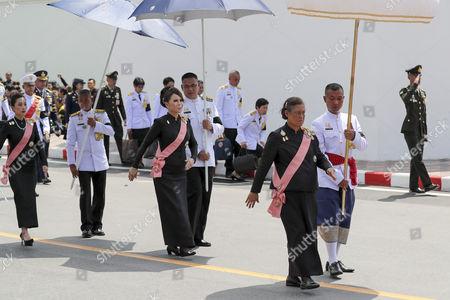 Stock Picture of Thailand's Princess Maha Chakri Sirindhorn (R), Thai Princess Ubolratana Rajakanya (C), elder sister of Thai King Maha Vajiralongkorn Bodindradebayavarangkun, and Princess Bajrakitiyabha (C), daughter of King Maha Vajiralongkorn Bodindradebayavarangkun, march with royal guards during the royal procession transferring the royal relics and ashes of the late Thai King Bhumibol Adulyadej in Bangkok, Thailand, 27 October 2017. Thais bid their final farewell to the late King Bhumibol Adulyadej in an elaborate royal funeral ceremony. King Bhumibol died at the age of 88 in Siriraj hospital on 13 October 2016 after 70 years on the throne.