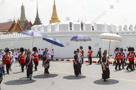 Thai Princess Sirivannavari Nariratana (L) and Princess Bajrakitiyabha (2-L) daughters of King Maha Vajiralongkorn Bodindradebayavarangkun, Thai Princess Ubolratana Rajakanya (2-R), elder sister of Thai King Maha Vajiralongkorn Bodindradebayavarangkun, and Thai Princess Maha Chakri Sirindhorn (R), march with royal guards during the royal procession transferring the royal relics and ashes of the late Thai King Bhumibol Adulyadej in Bangkok, Thailand, 27 October 2017. Thais bid their final farewell to the late King Bhumibol Adulyadej in an elaborate royal funeral ceremony. King Bhumibol died at the age of 88 in Siriraj hospital on 13 October 2016 after 70 years on the throne.