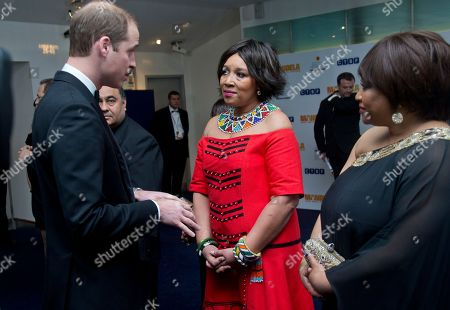 The Duke of Cambridge meets Zenani Mandela, centre and Zindzi Mandela, ahead of the UK Premiere of the Long Walk to Freedom, a film based on the South African President Nelson Mandela's autobiography of the same name, to the Odeon cinema in Leicester Square, central London