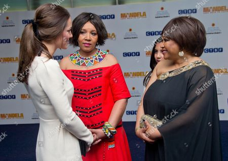 The Duchess of Cambridge meets Zenani Mandela, centre and Zindzi Mandela, ahead of the UK Premiere of the Long Walk to Freedom, a film based on the South African President Nelson Mandela's autobiography of the same name, to the Odeon cinema in Leicester Square, central London