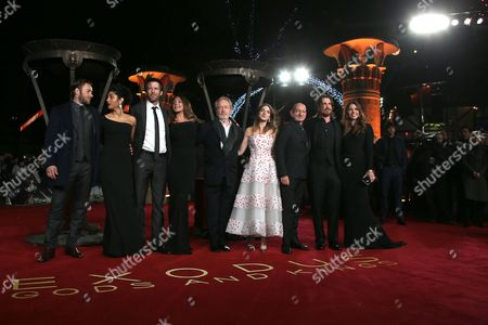 Actors Joel Edgerton, Golshifteh Farahani, Andrew Tarbet, Giannina Facio, director Ridley Scott and actors Maria Valverde, Sir Ben Kingsley, Christian Bale and Sibi Blazic pose for photographers upon arrival at the World premiere of the film, 'Exodus: Gods And Kings,' in London. As the new film hits theaters on Friday, Dec. 12, 2014, Scott talks to Associated Press in an interview about war over religion, diversifying Hollywood's leading men and women, and why there's a huge painting of a Jack Russell terrier in his LA home