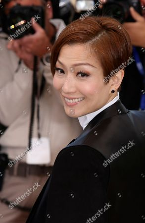 Actress Sammi Cheng poses for photographers during a photo call for the film Blind Detective at the 66th international film festival, in Cannes, southern France