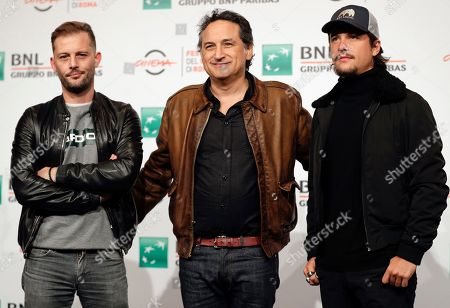 """From left, actor Nicolas Duvauchelle, director Thierry Klifa and rapper Nekfeu pose for photos at the photo call of the movie """"Tout Nous Separe"""", at the 12th edition of the Rome Film Fest, in Rome"""