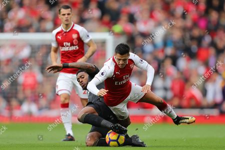 Alexis Sanchez of Arsenal and Leroy Fer of Swansea City fight for the ball - Arsenal v Swansea, Premier League, Emirates Stadium, London - 28th October 2017.