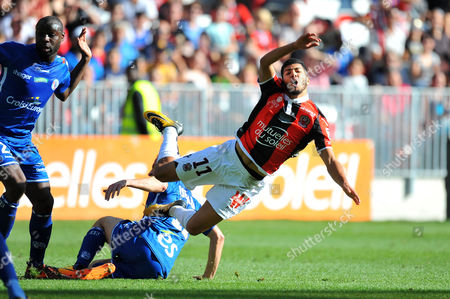 Nice's Bassem Srarfi is tackled by Strasbourg's Dimitri Lienard
