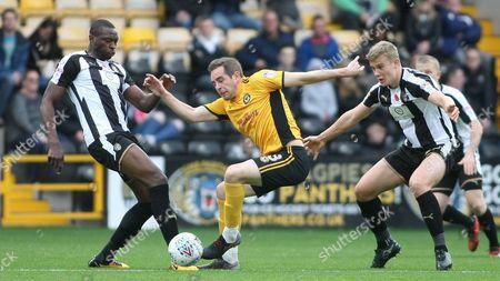 Shola Ameobi and Ryan Yates keep a close eye on Newport's Matt Dolan
