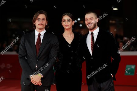 "From left, actor Luca Marinelli, actress Valentina Belle and actor Lorenzo Richelmy walk the red carpet on the occasion of the screening of the movie ""Una Questione Privata"", at the 12th edition of the Rome Film Fest, in Rome"