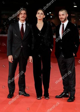 """From left, actor Luca Marinelli, actress Valentina Belle and actor Lorenzo Richelmy walk the red carpet on the occasion of the screening of the movie """"Una Questione Privata"""", at the 12th edition of the Rome Film Fest, in Rome"""