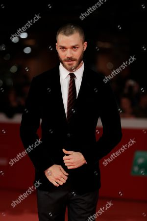 """Actor Lorenzo Richelmy poses on the red carpet on the occasion of the screening of the movie """"Una Questione Privata"""", at the 12th edition of the Rome Film Fest, in Rome"""