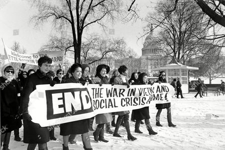 Members of a women's brigade protesting the Vietnam War and the social crisis at home march at a peace parade led by former Montana congresswoman Jeannette Rankin in Washington, D.C. on Jan. 15, 1968. In the background is the U.S. Capitol building. Carrying the sign, from left, are: Ruth Krause, Mrs. Vel Phillips, Wenn Griffin, Ruth Warwick, and Lucy Montgomery. (AP Photo)