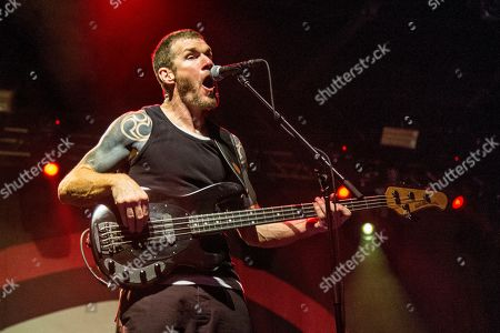 Tim Commerford of Prophets of Rage performs at the Voodoo Music Experience in City Park, in New Orleans