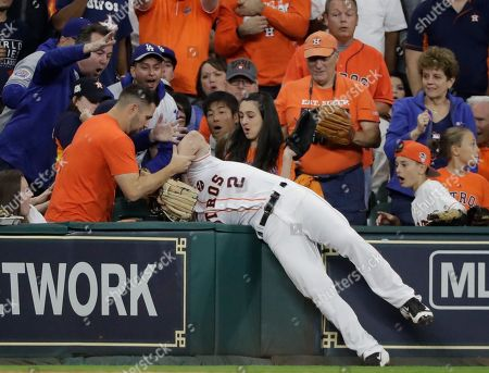 Houston Astros' Alex Bregman can't catch a foul ball hit by Los Angeles Dodgers' Andre Ethier during the seventh inning of Game 3 of baseball's World Series, in Houston