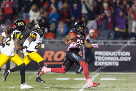 Ottawa Redblacks running back William Powell (29) runs for the winning score in the fourth quarter during the CFL game between Hamilton Tiger-Cats and Ottawa Redblacks at TD Place Stadium in Ottawa, Canada. Redblacks won the game by a score of 41-36