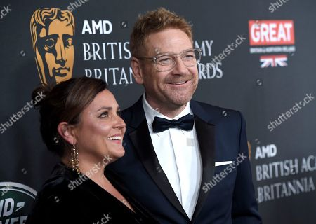 Lindsay Brunnock, Kenneth Branagh. Kenneth Branagh, right, Lindsay Brunnock arrive at the BAFTA Los Angeles Britannia Awards at the Beverly Hilton Hotel, in Beverly Hills, Calif